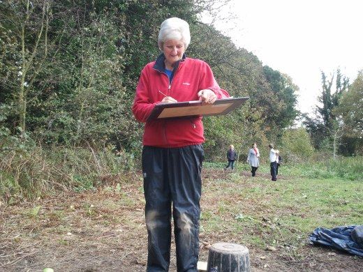 Volunteer Sheila working on her first archaeological plan.