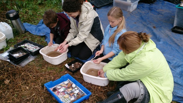 Some of our home-school kids excavating, sieving and winds washing on their visit to site.