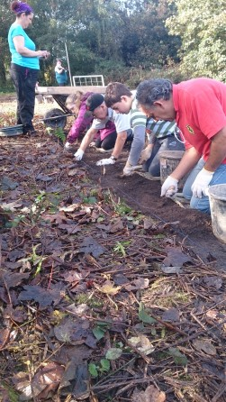 Our home-schoolers and their parents working through the topsoil.